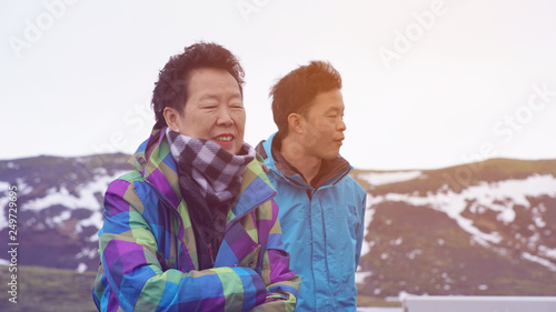 Fotografie, Obraz  Asian son take senior mother to travel together in Iceland family bond