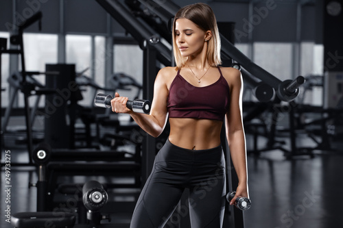 Sexy athletic girl working out in gym Wallpaper Mural