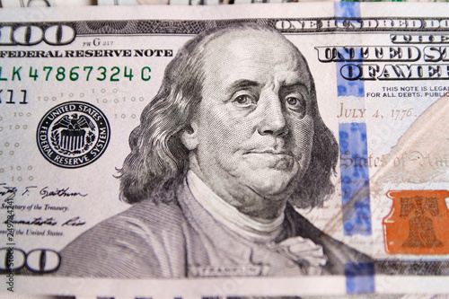 Fotografie, Obraz  A pile of one hundred US banknotes with president portraits