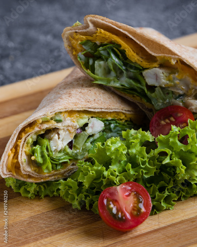 Staande foto Snack tasty wrap with chicken meat and greens