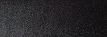 Silver Sequins Pattern. Sparkling Sequins On Black Wool Fabric As Background