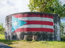 An Abstract Background Image Of The Flag Of Puerto Rico Painted On To A Concrete Tank.