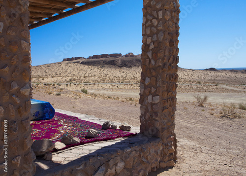 bed under a canopy for rest in the shade in the desert near the ancient fortress of Khorezm Wallpaper Mural