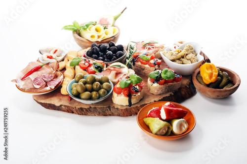 Fototapeta Italian antipasti wine snacks set. Cheese variety, Mediterranean olives, pickles, Prosciutto di Parma, tomatoes, artichokes obraz