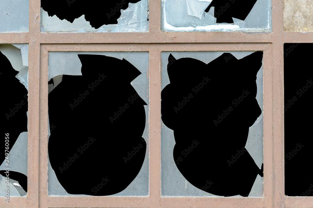 Fototapeta Old window with broken panes of glass