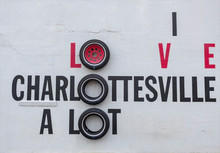 I LOVE CHARLOTTESVILLE Roadside Attraction Sign Made With Tires Mounted On White Wall.