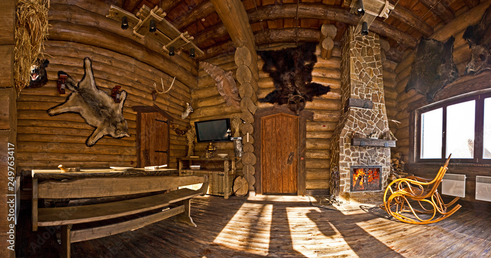 country style interior in hunter chalet with fireplace Foto ...