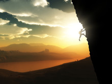 3D Extreme Rock Climber Against A Sunset Landscape