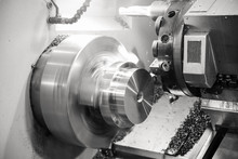 CNC Lathe Processes Metal Part.