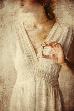 Woman Holding Old Key In A Hands
