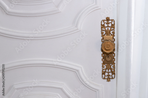 Fototapeta maçaneta dourada