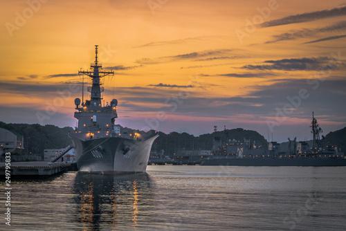 Photo Naval warships at sunset