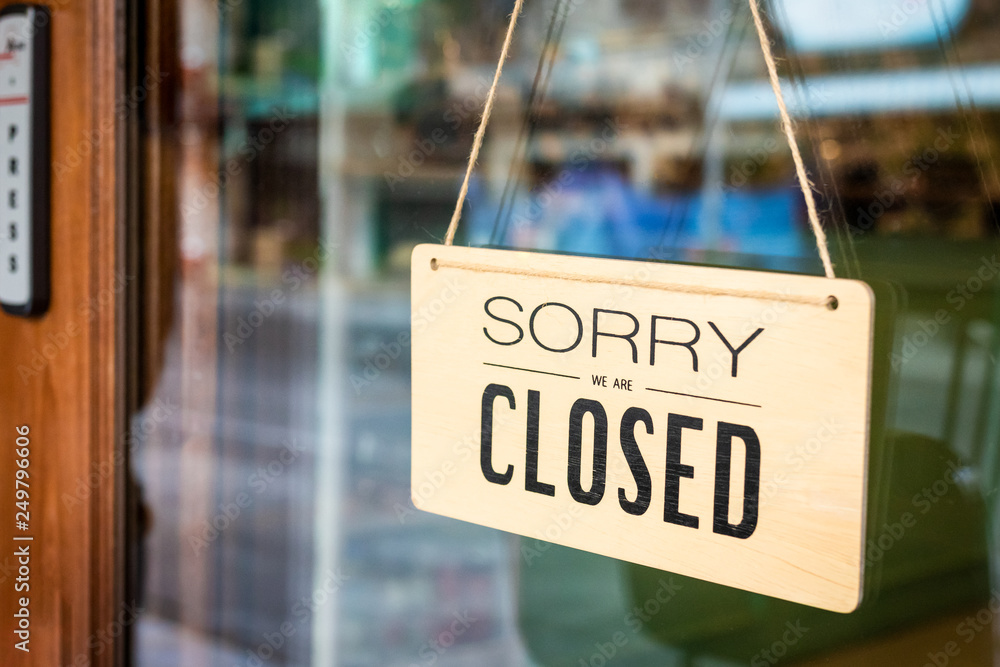 Fototapeta Sorry we are closed sign board hanging on door of cafe