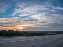 Sunrise Over New Texas Road