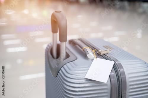 Obraz na plátně  Luggage holder tag blank label on suitcase / baggage put letter Travel insuranc