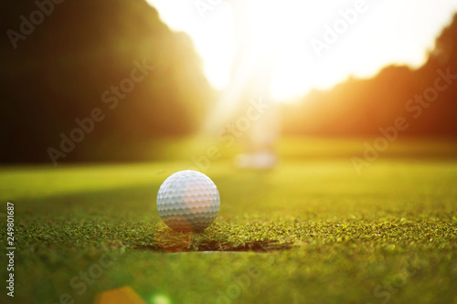 Blurred golfers are putting golf in the evening golf course golf backglound in Thailand