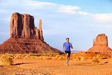 Trail Running Runner Athlete Doing Race Goal Challenge. Fitness Man Sprinting Across Desert In Monument Valley, Cross Country Marathon Endurance Training In Arizona, Utah, USA. American Travel.