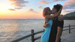 Beautiful Young Couple in Love Hug and Kiss Sea view Sunset time