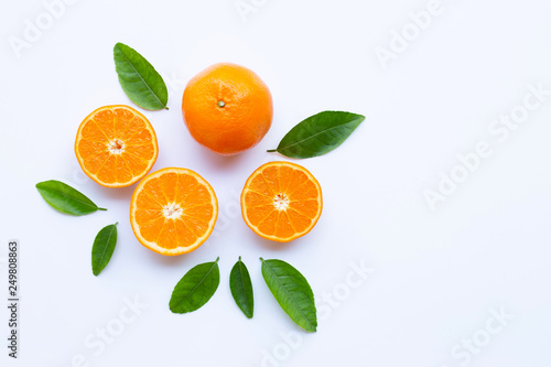 High vitamin C. Fresh orange citrus fruit with leaves isolated on white