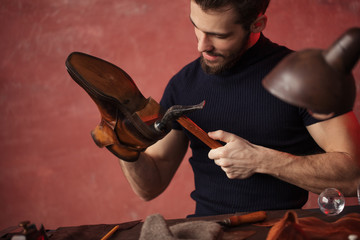 master making a new pair of shoes, close up photo,