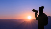Young Hipster Woman Photographer Taking Photo With Sunset On Mountain Natural Background.