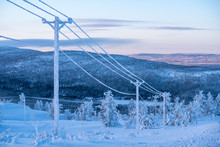 Frost And Snow Covered Power Lines During Very Cold Winter Against Sky In Finland