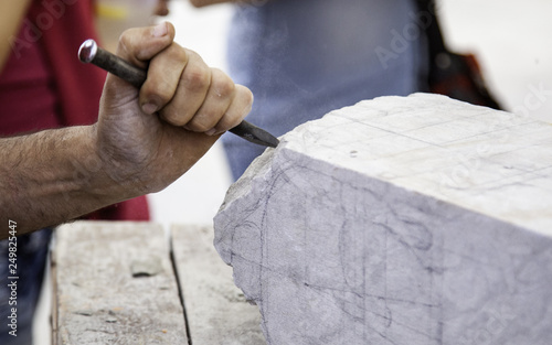 Carving stone, craftsman shaping stone - 249825447