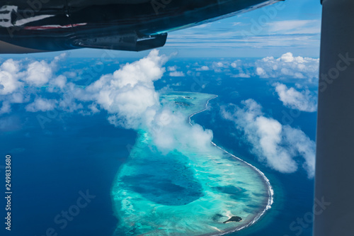 Fototapeta Maldives from the Sky with the blue sea and white sand and beach in the indian o