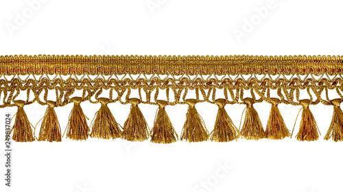 Fotografie, Obraz  Fringe. Yellow braid with tassels. Isolated on white background
