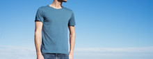 Photo Of A Man Wearing Blue T-shirt. Blue Sky On Background