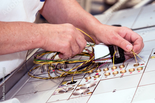 Sensational Hands Of An Employee Who Tests A Part Of The Wiring For Cars At A Wiring Digital Resources Minagakbiperorg