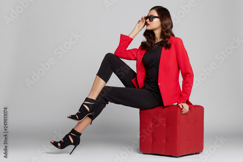 Fototapeta  Fashion young woman in red jacket.