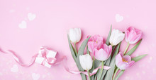 Gift Box And Beautiful Spring Tulip Flowers On Pastel Pink Background. Banner For Women Day, Mother Day. Flat Lay.