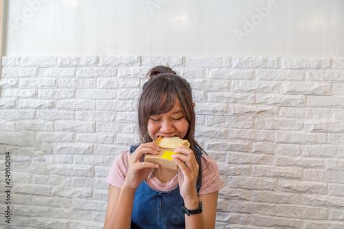Fototapeta Girl eating cheese bread grill. obraz