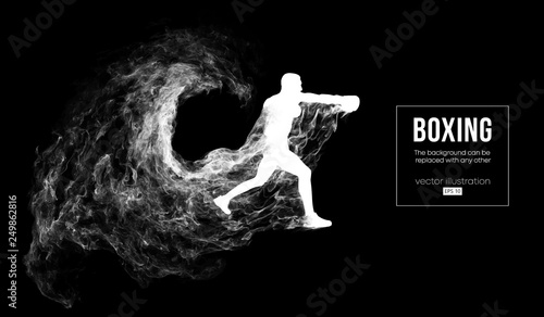 Photo Abstract silhouette of a boxer, mma, ufc fighter on the dark, black background from particles, dust, smoke, steam
