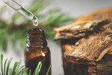 pine bark tincture dripping from glass pipette