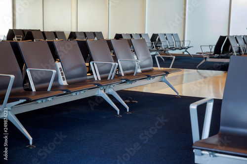 Fotografering  Empty airport departure lounge terminal waiting area with chairs