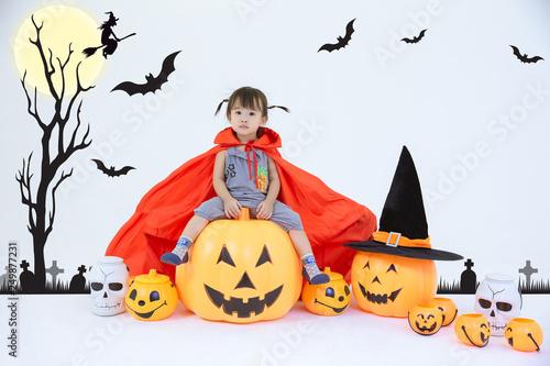 Baby sitting on pumpkin © Voradech Triniti