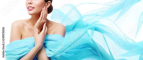 Obraz na plátně  Beauty Makeup Skin Care, Woman Touching Face by Hand, Young Girl in Blue Waving