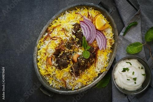Homemade Beef Biryani served with Raita yogurt dip, overhead view Canvas Print