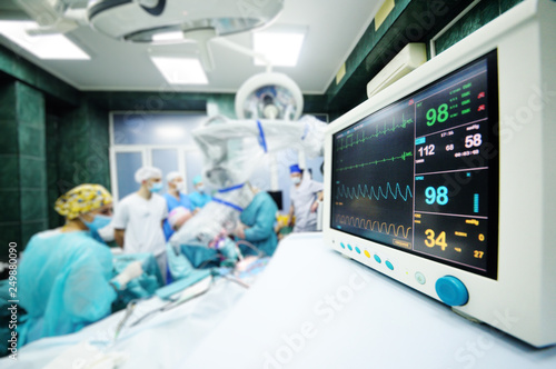 a group of surgeons operate on the patient's vital functions monitor close-up Wallpaper Mural