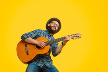 Bearded Man Playing Guitar