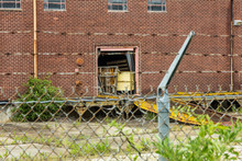 Old Brick Abandoned Factory Waiting For Reuse Behind Barbed Wire Fence