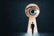 Leinwandbild Motiv Abstract keyhole with businessman eye