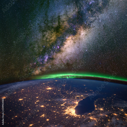 Chicago and lake Michigan from space at night, with the aurora Borealis and the Milky Way Canvas Print