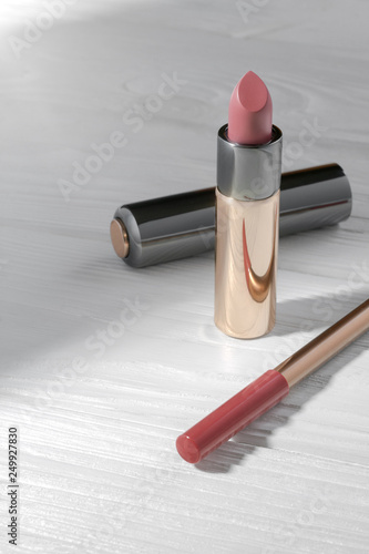 Fotografie, Obraz  Pink Lipstick and pink lip pencil on wooden table