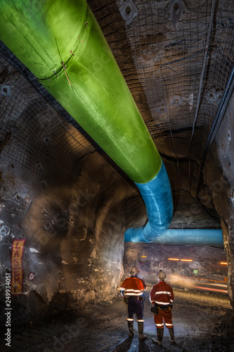 Miners inspecting an underground ventilation system in a gold mine in Australia Fototapet