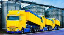 On The Road A Car For Transportation Of Grain . The Yellow Truck With The Trailer . Agricultural Silos .Tank Farm . Commercial Transport .  Truck Transport Container   .