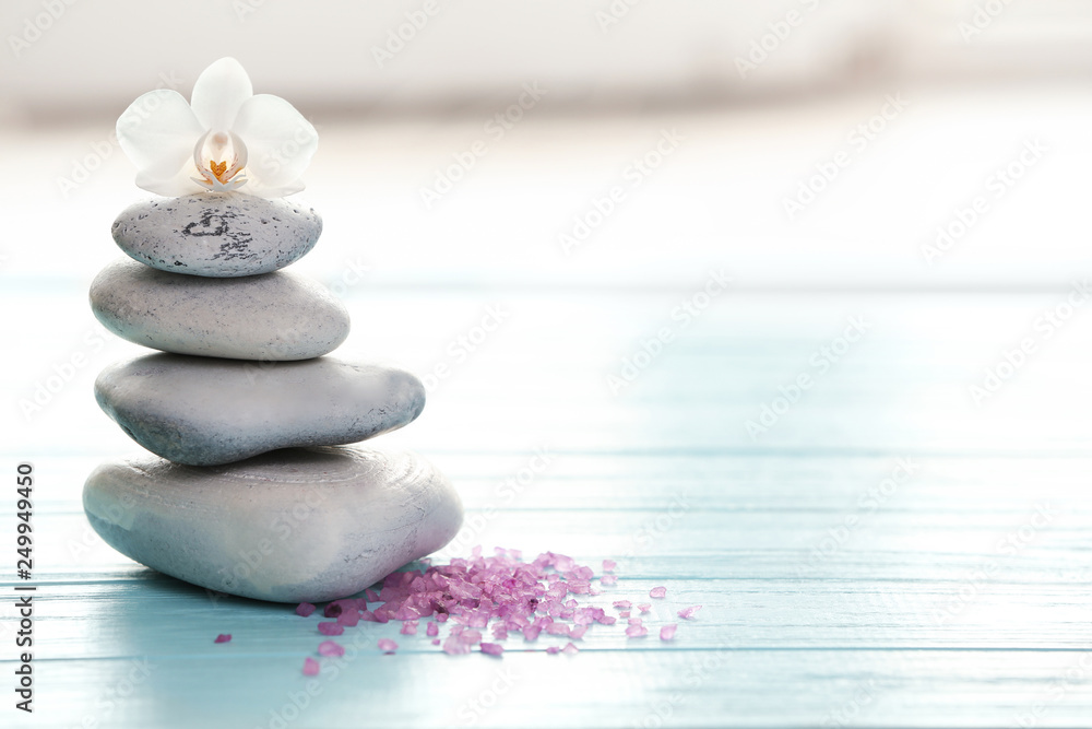 Fototapety, obrazy: Spa stones, sea salt and flower on table against blurred background. Space for text