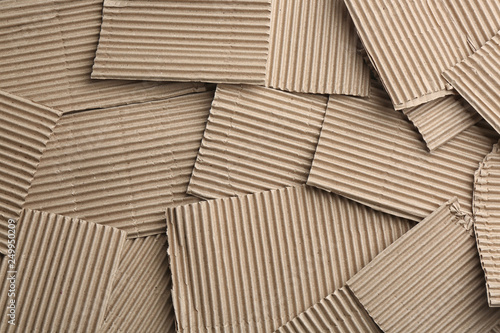 Foto  Pieces of cardboard as background, top view. Recycling concept